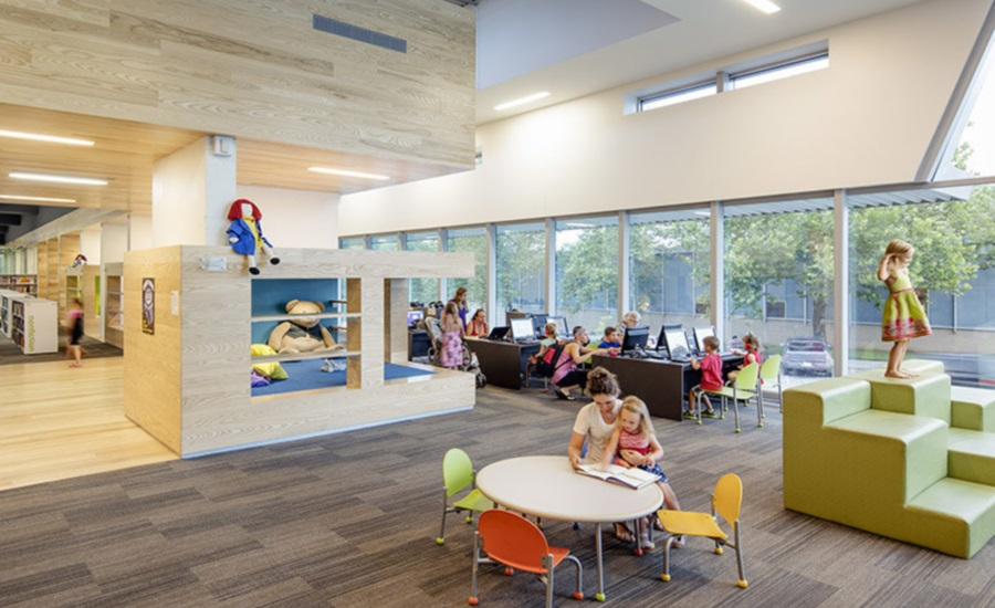 In The Childrens Area Of Lawrence Public Library Renovation And Expansion By Gould Evans Reading Niches Inserted Between Concrete Fins